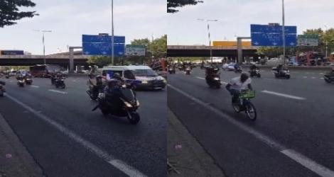 Il suit le car des Bleus sur l'autoroute, avec un Vélib !