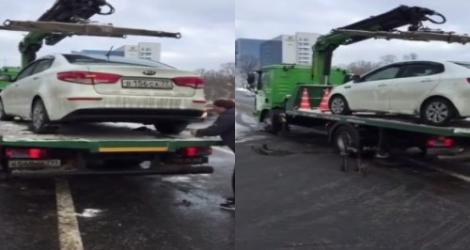 Cet homme ne veut vraiment pas se faire embarquer sa voiture par la fourrière (Russie)